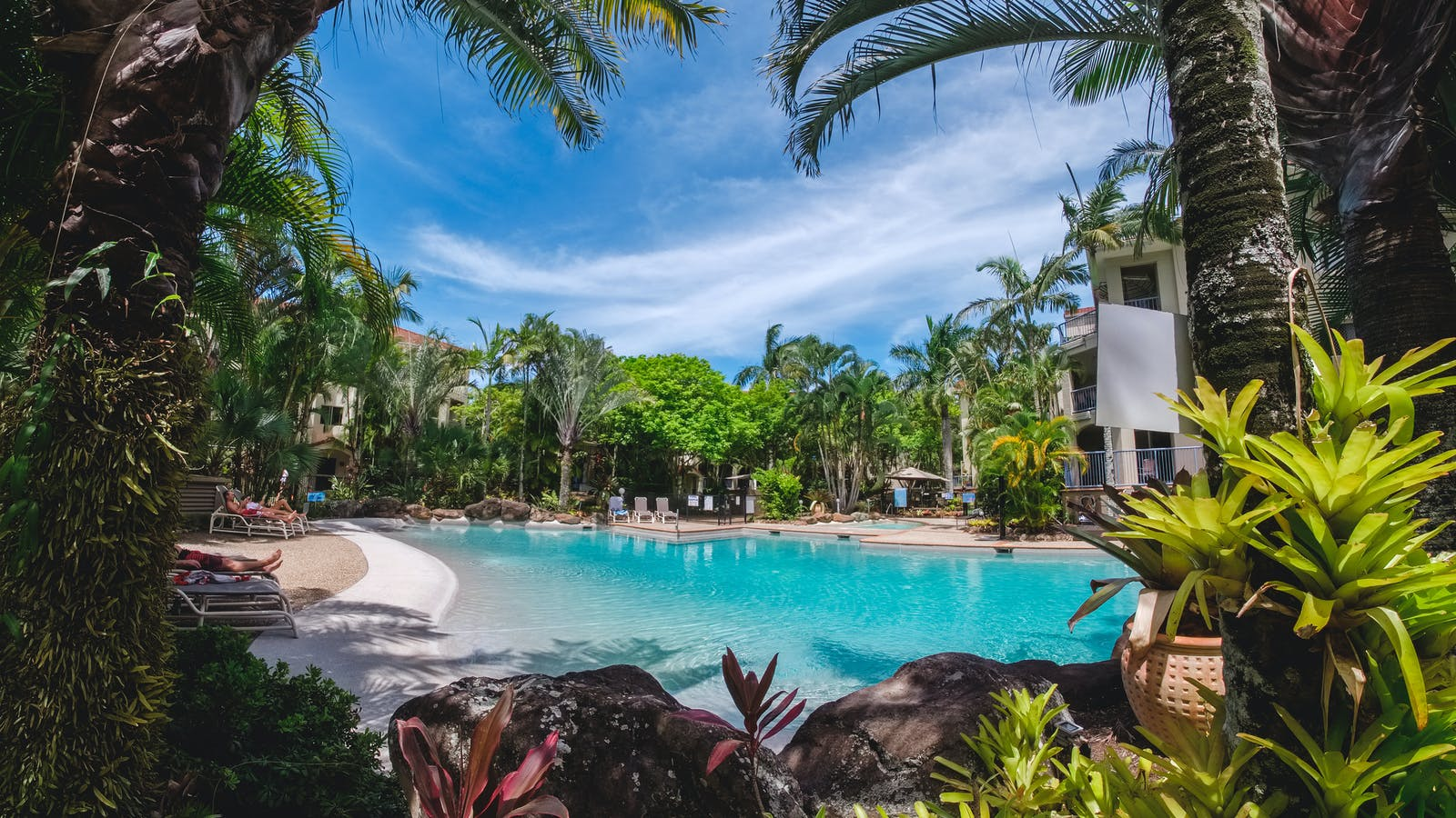 Our pools set in lush tropical gardens