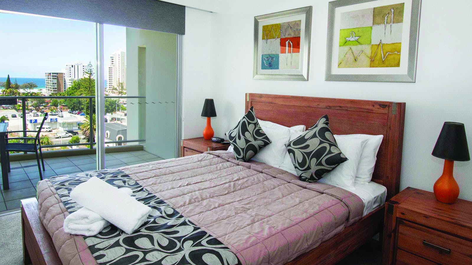 View of a master bedroom showing access to balcony and view over Surfers Paradise and Ocean
