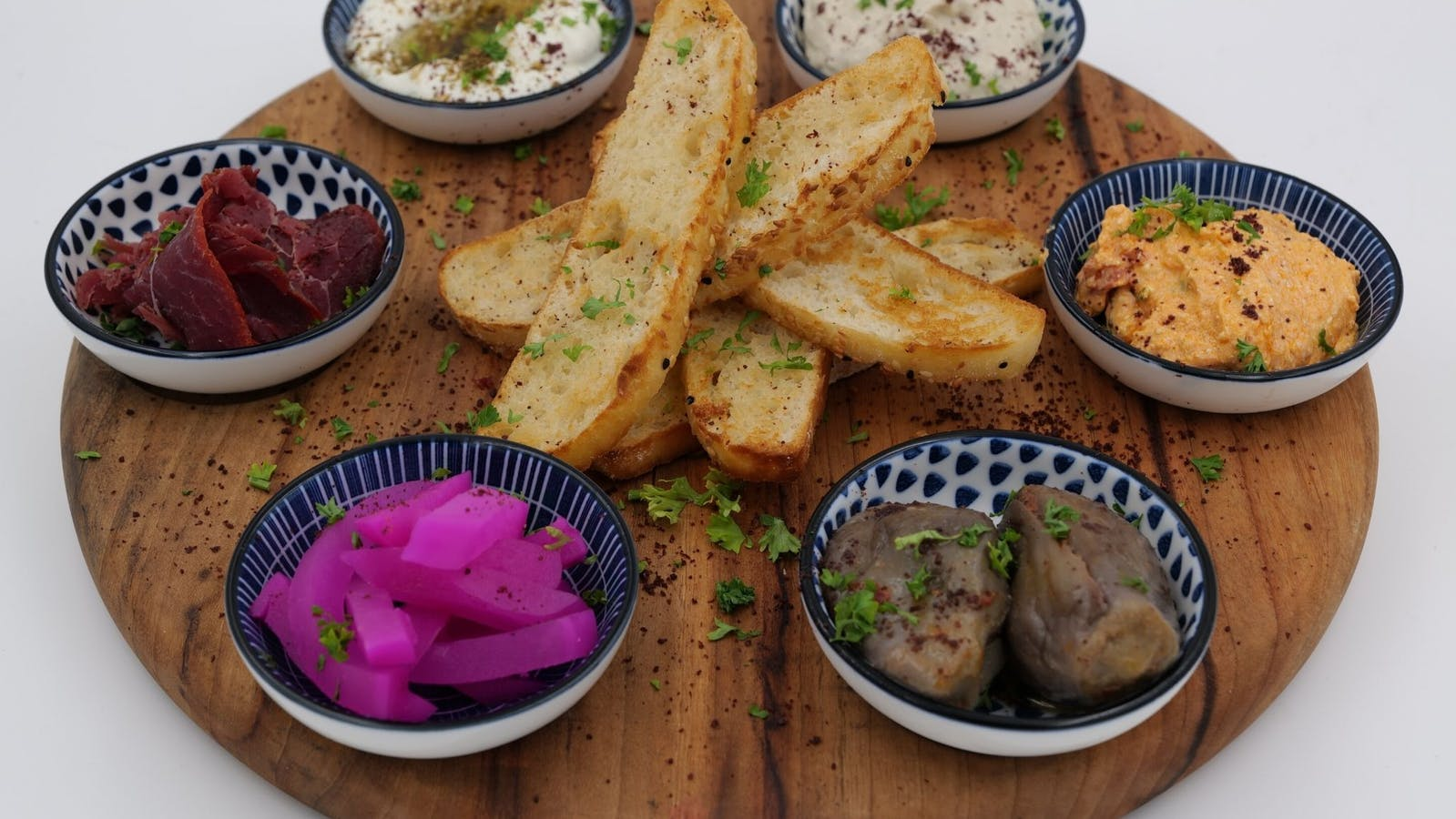 Turkish bread, hummus, sun-dried tomato, dips, eggplant, basturma, baba ghanoush, turnip
