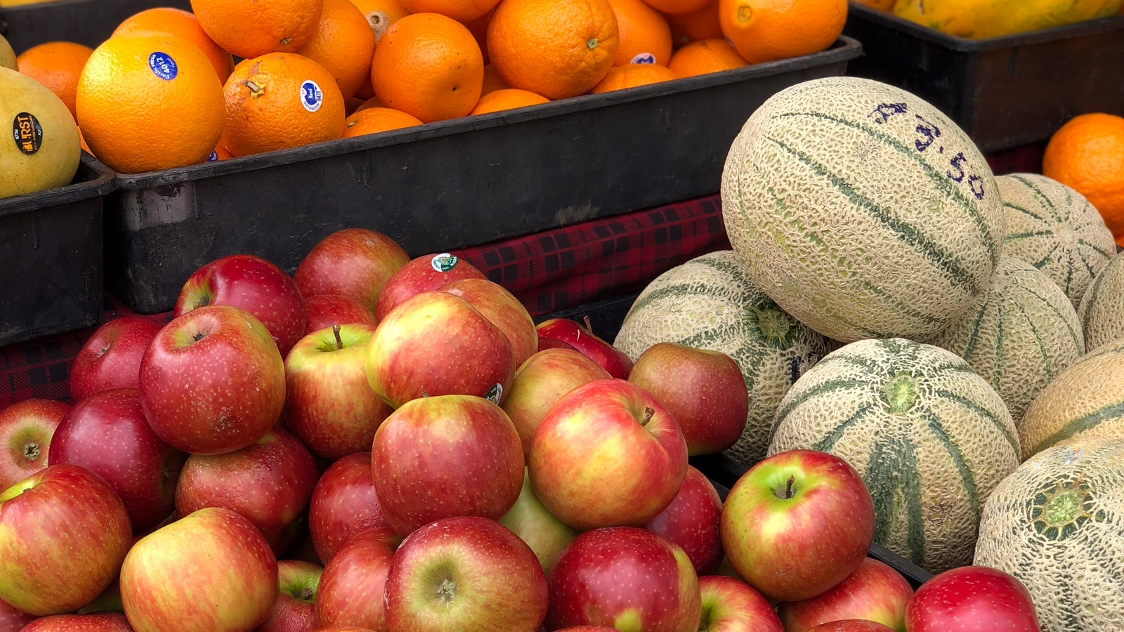 all kinds of local produce can be found at the markets. In this phot there are apples rockmelons anl