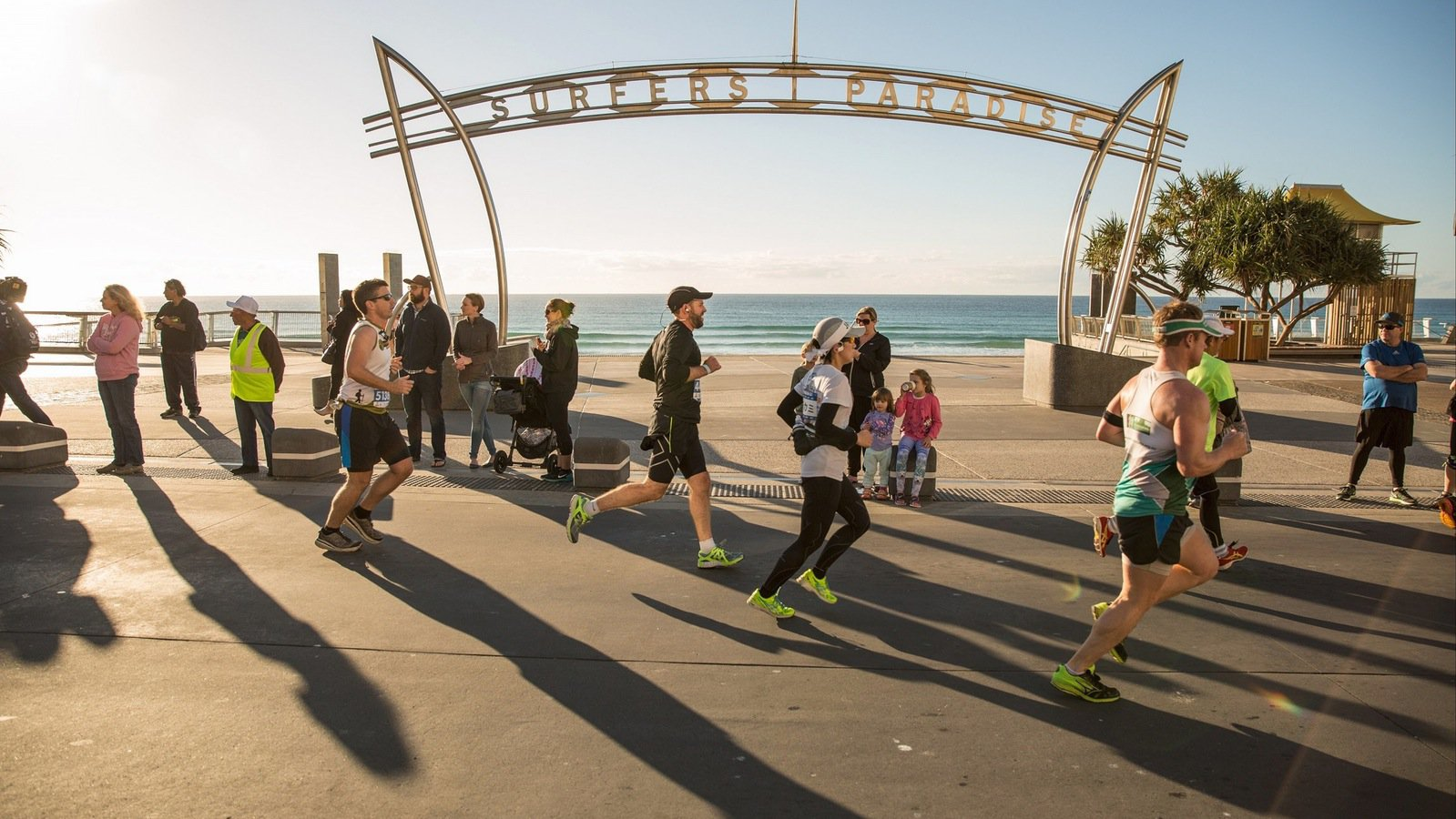 Runners passing Surfers Paradise