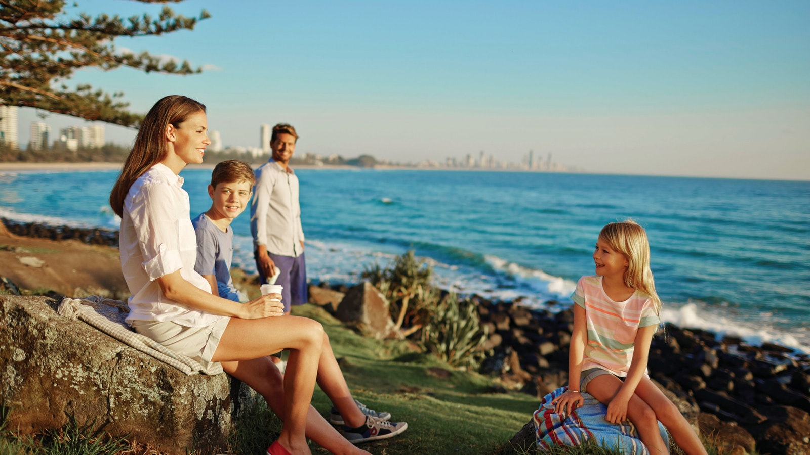 Family resting on Burleigh Hill, Burleigh National Park