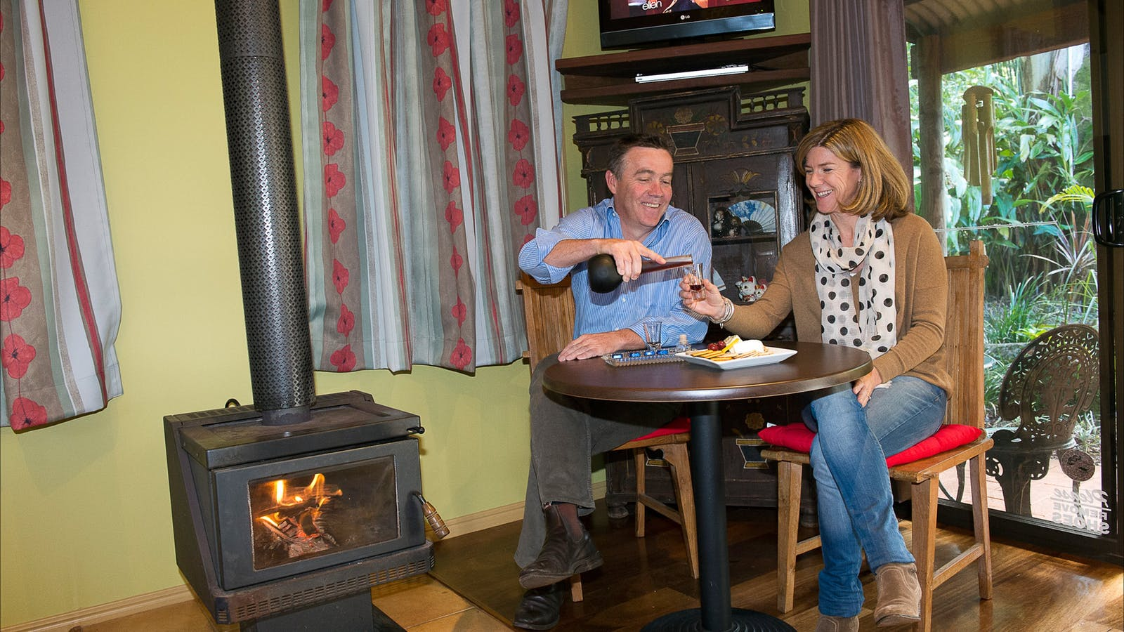 Couple enjoying portwine & cozy wood fire