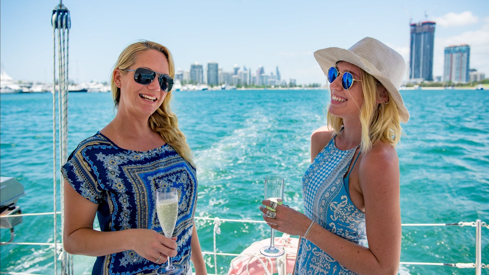 Two girls sipping champagne on a catamaran