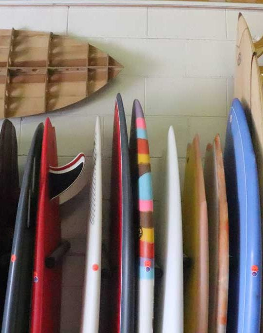 Surfboards leaning against a wall