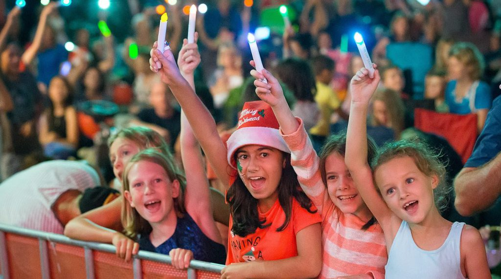 kids with glow sticks at Broadbeach Christmas Carols