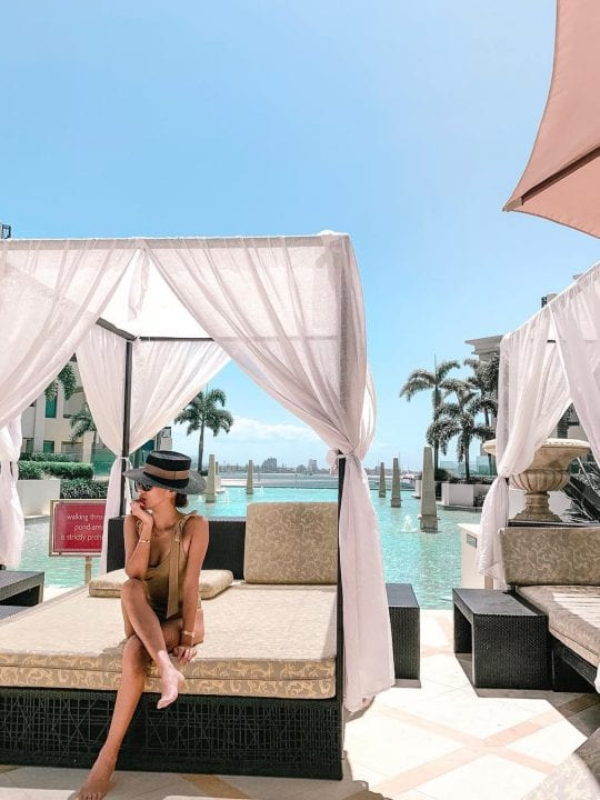 Woman relaxing in cabana at Palazzo Versace Gold Coast
